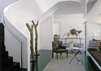Stairs with view of Foyer